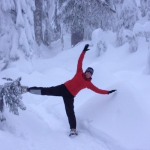 Laura standing on one snowshoe