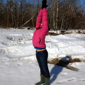 Laura in a standing salute in the snow