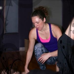 Laura crouching to teach