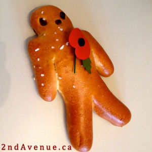 Man-shaped pastry with red poppy