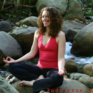 Laura sitting in easy pose meditating