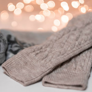 Beige woolen socks with bokeh effect in the background